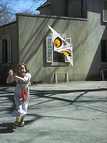 Miriam running to loft a kite