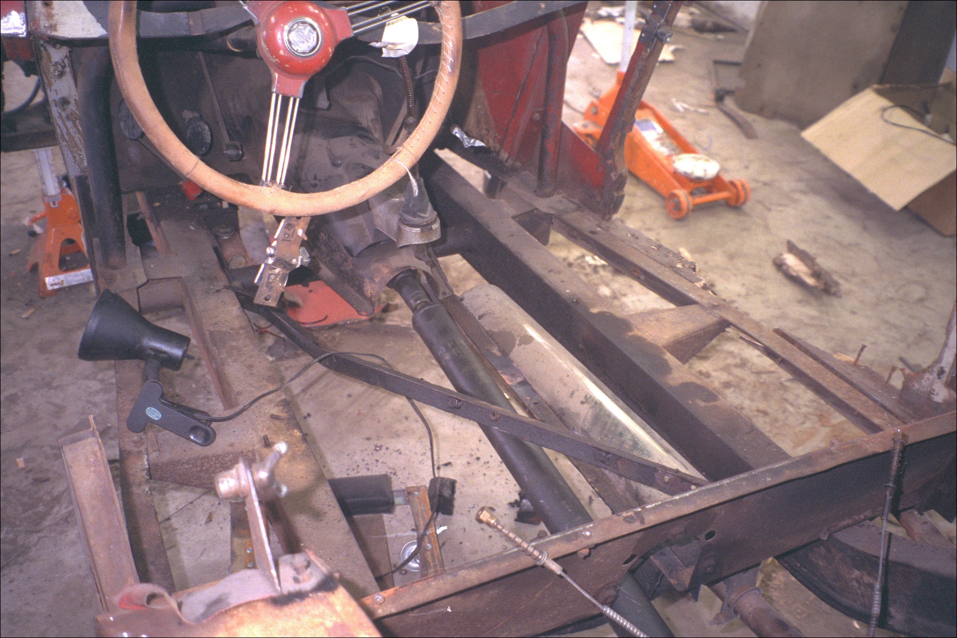 Stripping power train out of body and frame